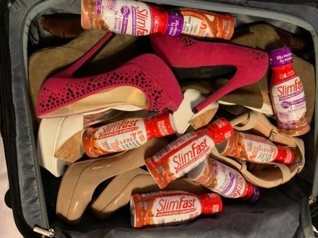 SlimFast Ready to Drink Shakes in a suitcase with shoes