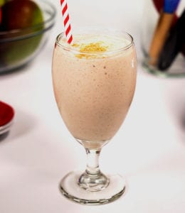 SlimFast Advanced Gingersnap Smoothie in a stemmed glass.