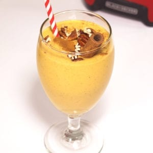 Pumpkin Pecan Pie Smoothie in a stemmed glass.