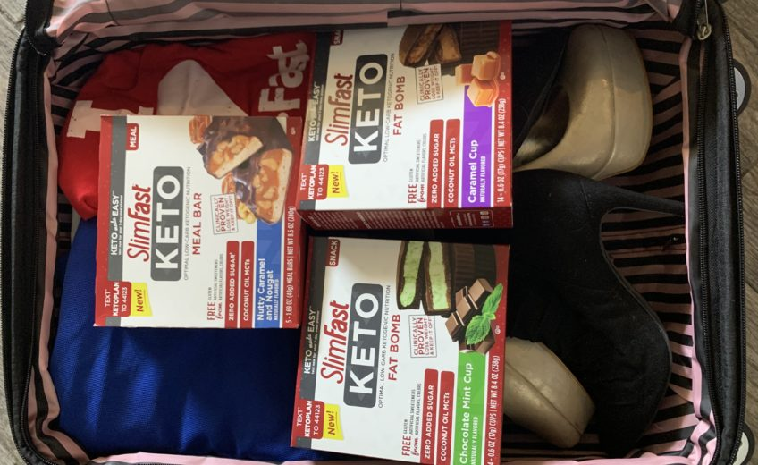 Hazely's suitcase full of SlimFast Keto Bars and Fat Bombs